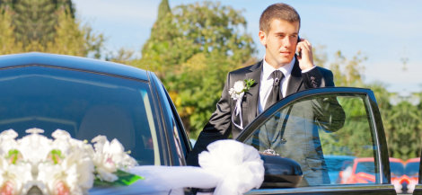 driver holding a cellular phone